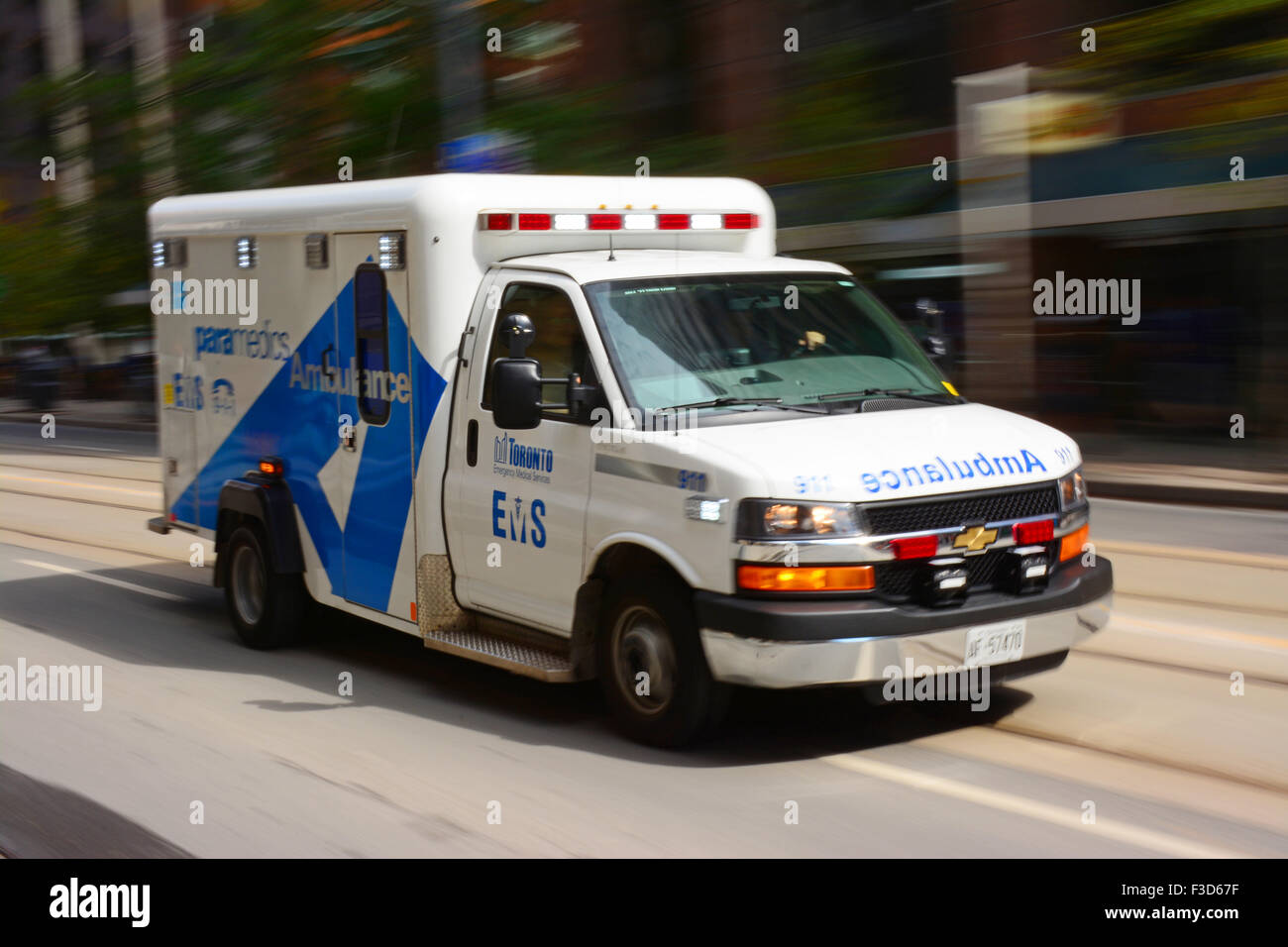 Ambulance rushing in Toronto streets - Stock Image