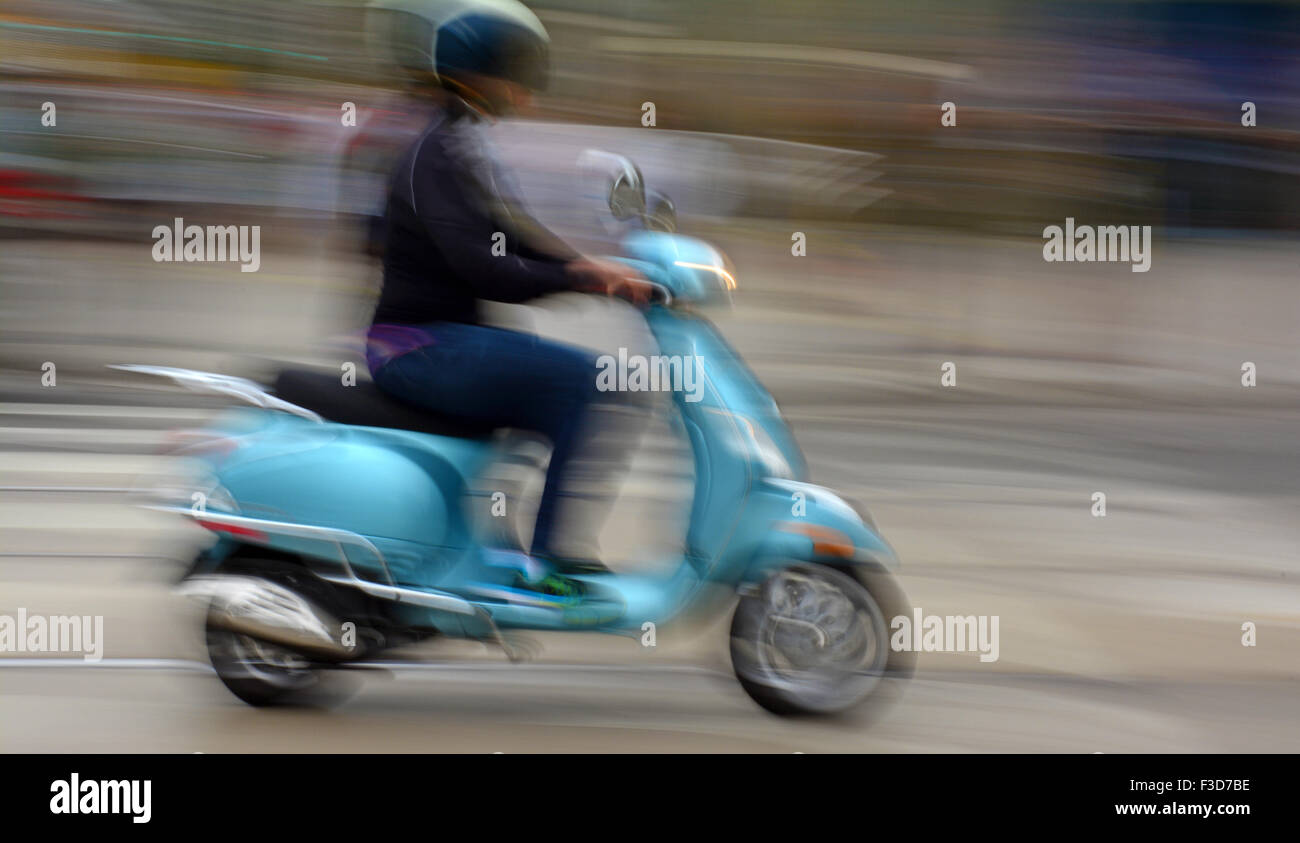 Motorcycle in blurred motion - Stock Image
