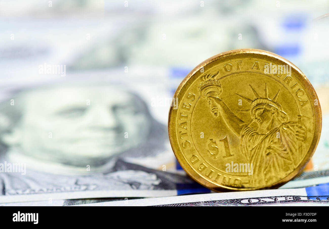 a coin in the dollar on the American banknotes - Stock Image