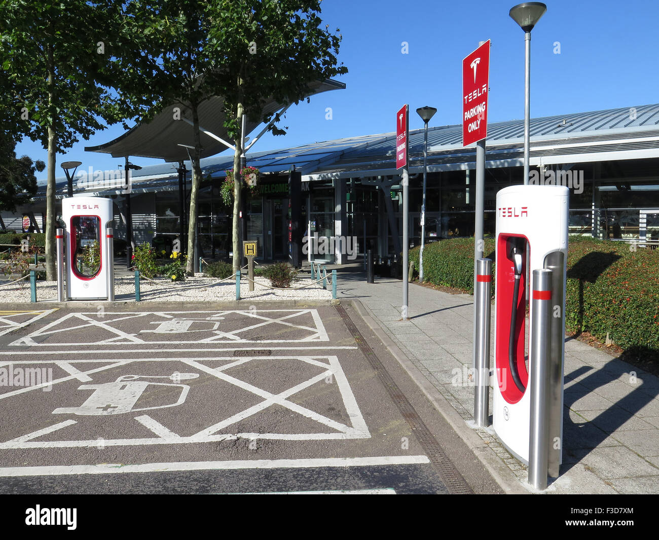 Electric Car Charging Point at South Mimms Motorway Services on the M25 for Tesla Cars - Stock Image