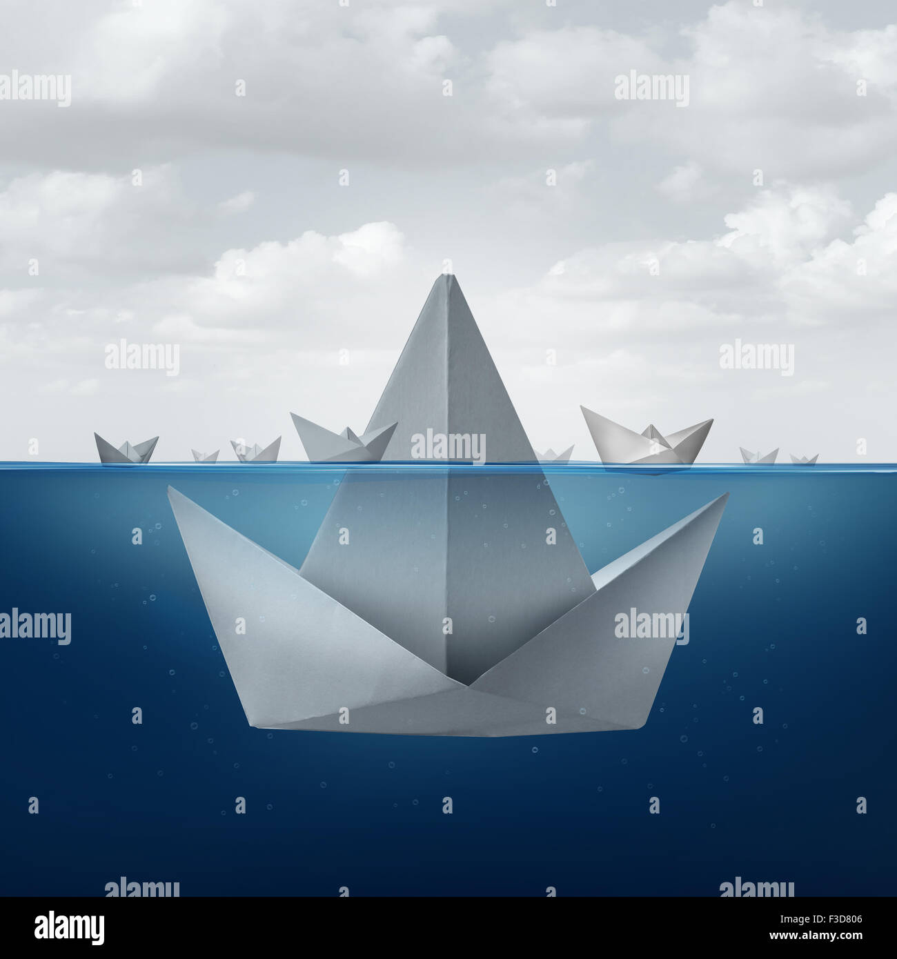 Business ignorance and fear concept as a group of paper boats floating around the tip of a giant origami sail boat - Stock Image