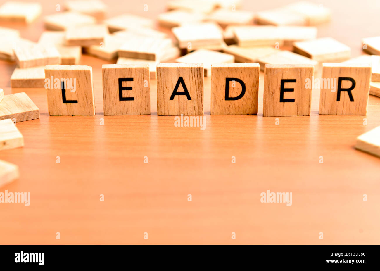Leader conceptual text on wooden tiles - Stock Image