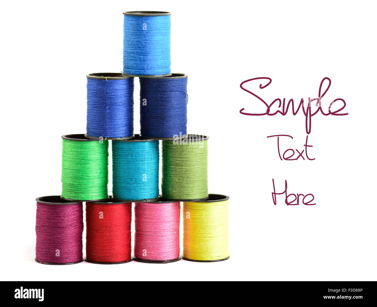 Sewing threads multicolored at white background - Stock Image