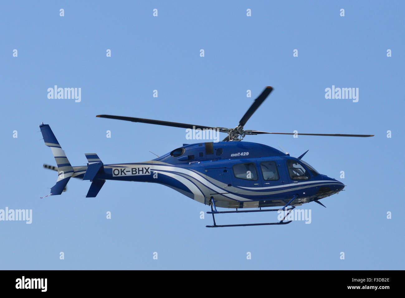 Bell 429 Global Ranger OK-BHX operated by Bell Helicopters comes in to land at London's Excel exhibition centre - Stock Image