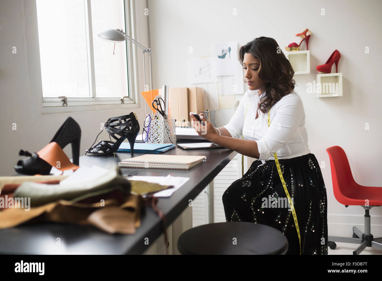 Young woman working in office Stock Photo