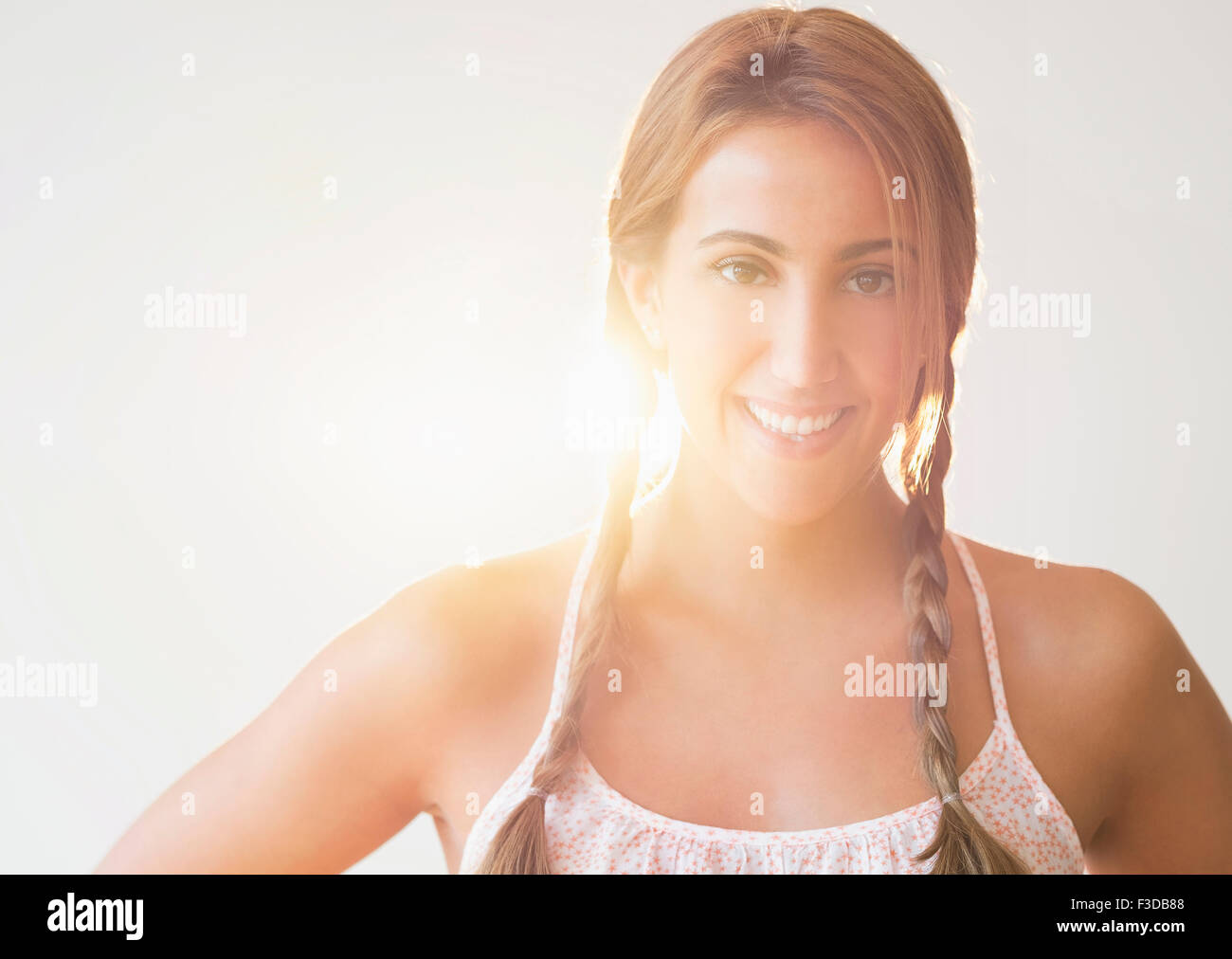 Portrait of young woman in studio - Stock Image