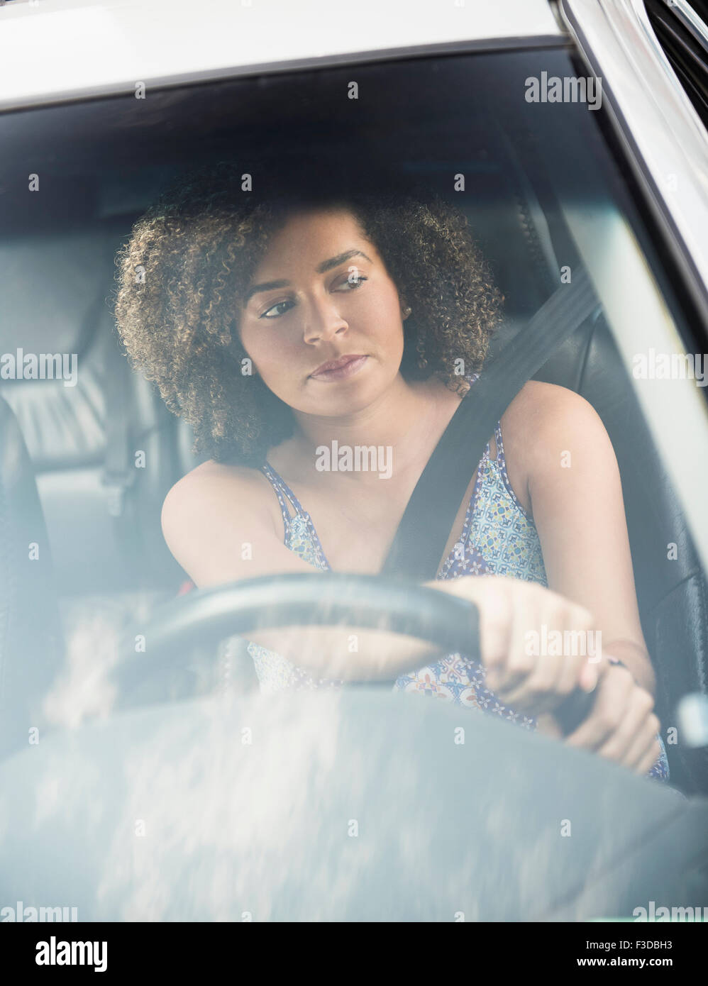 Young woman driving car - Stock Image