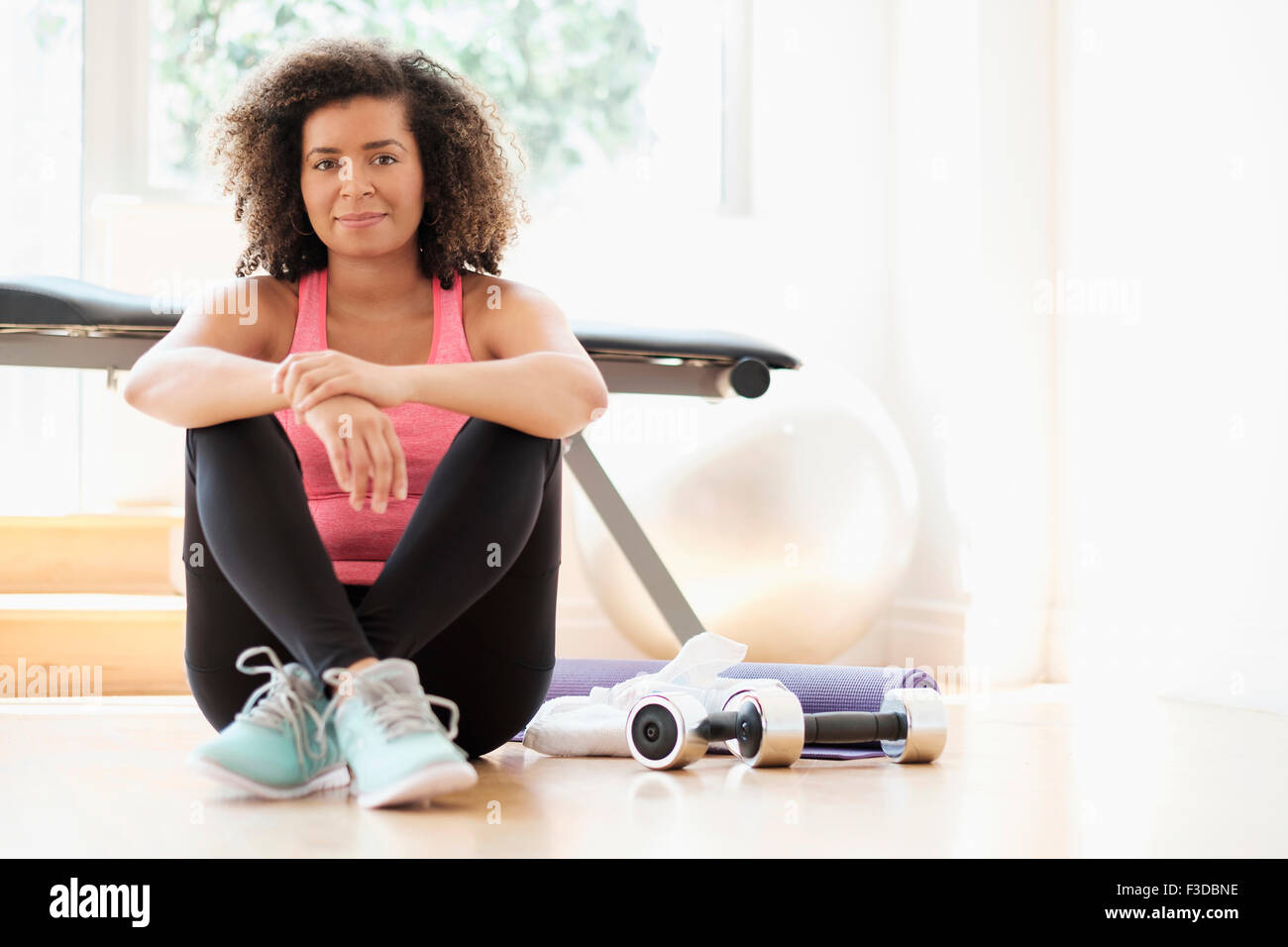 Portrait of young woman at gym - Stock Image