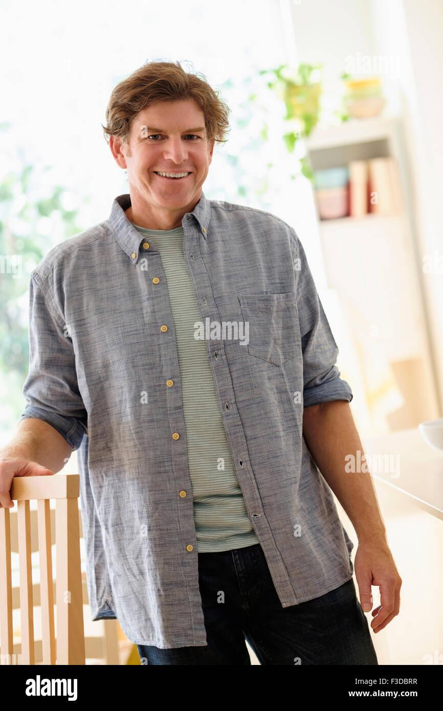 Portrait of mature man indoors - Stock Image