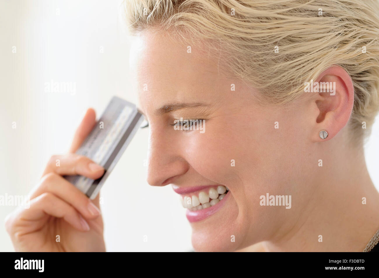 Young woman spending money - Stock Image