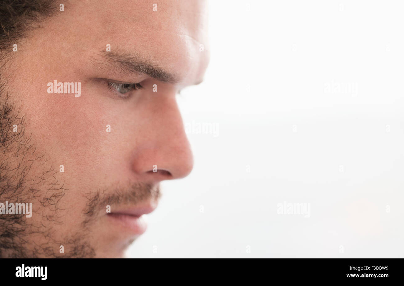 Side-view of pensive businessman - Stock Image