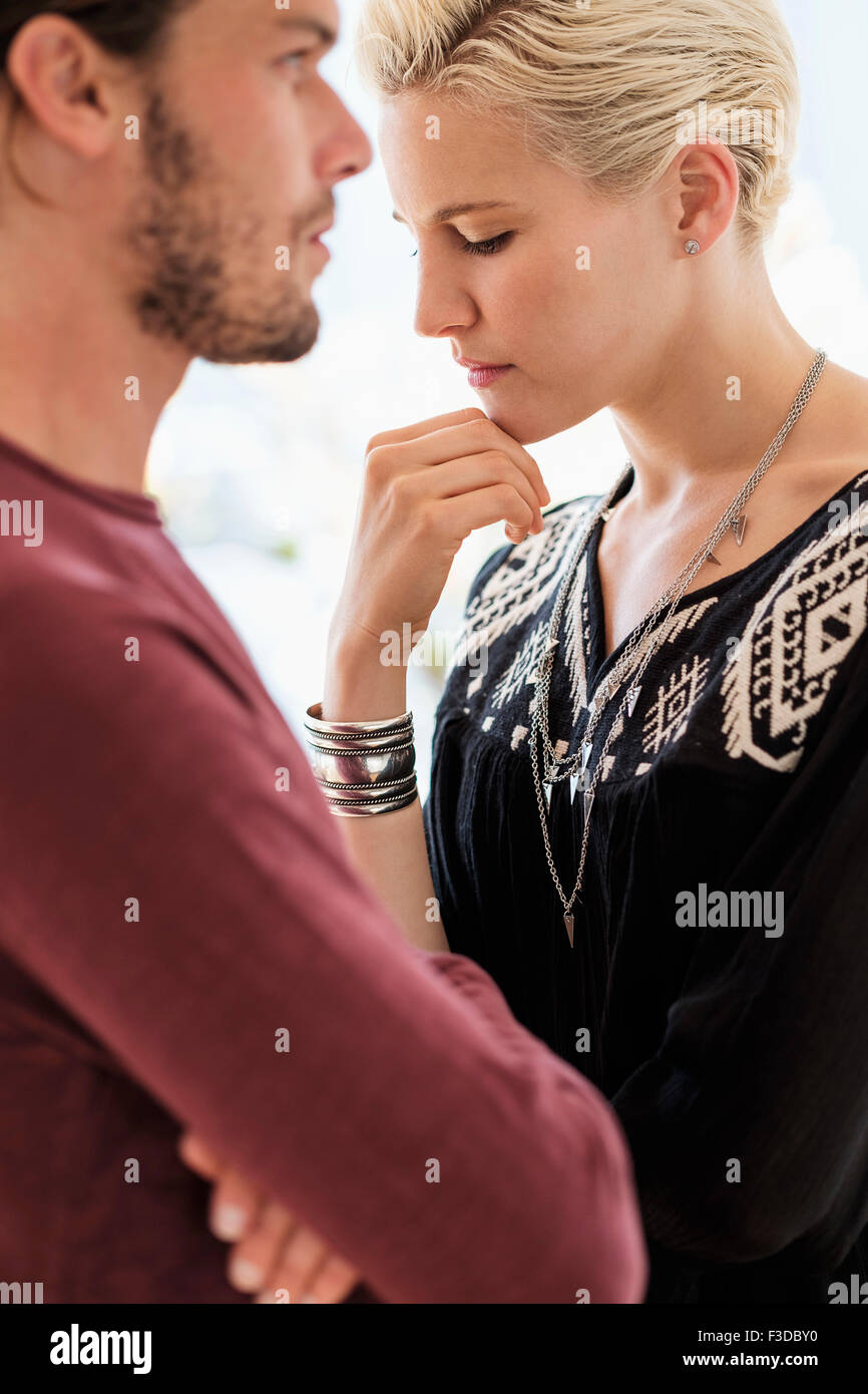 Couple arguing in living room Stock Photo
