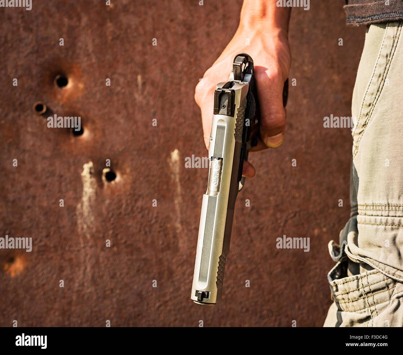 Holding Gun Stock Photos & Holding Gun Stock Images