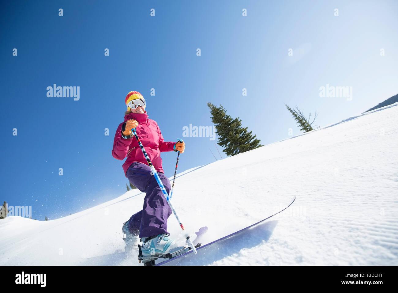 Woman skiing downhill - Stock Image