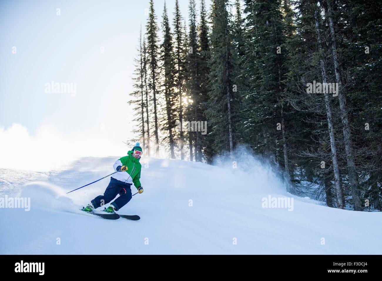 Man skiing downhill Stock Photo