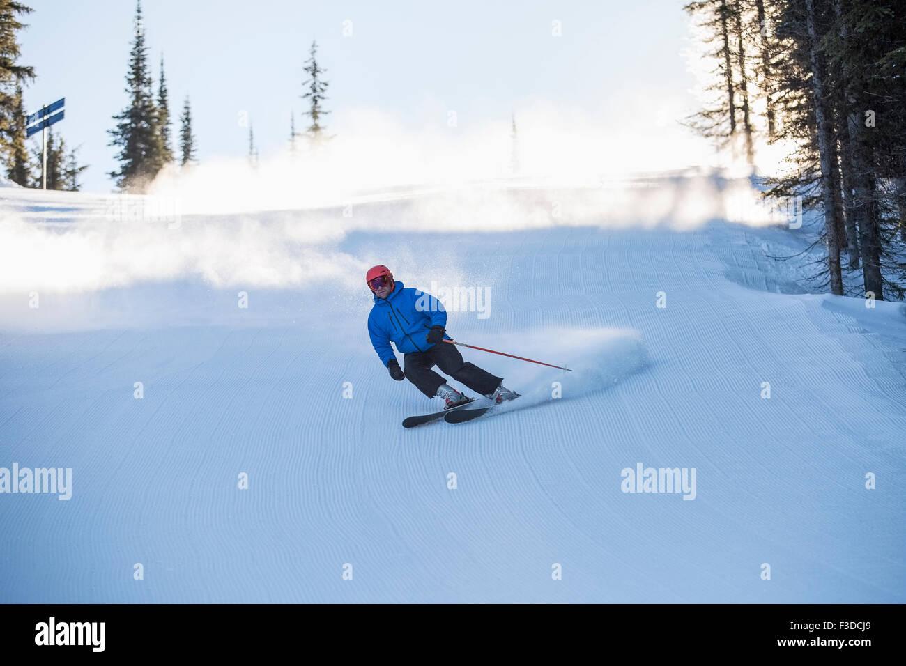 Man skiing downhill - Stock Image