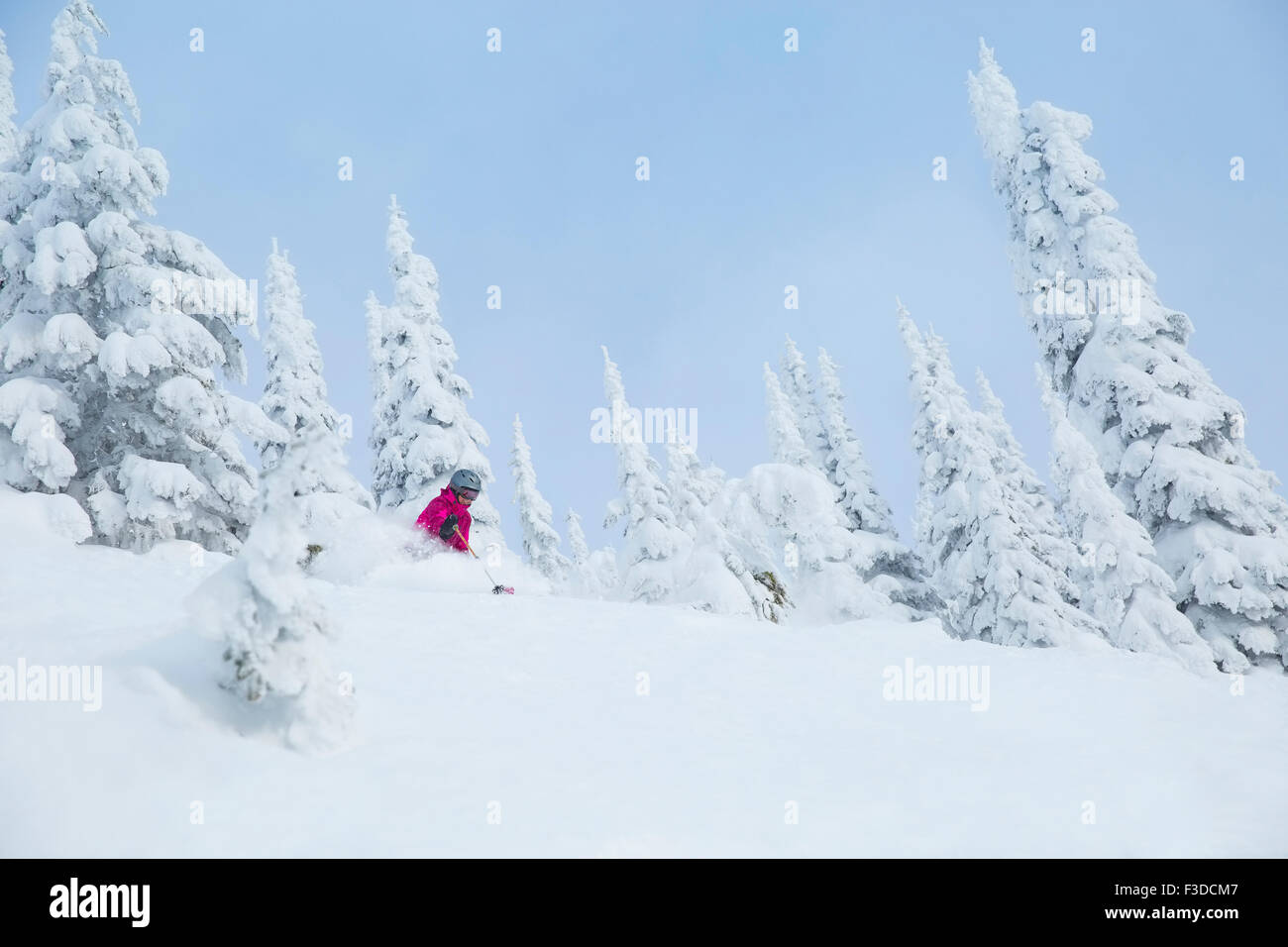 Low angle view of mature woman on ski slope - Stock Image