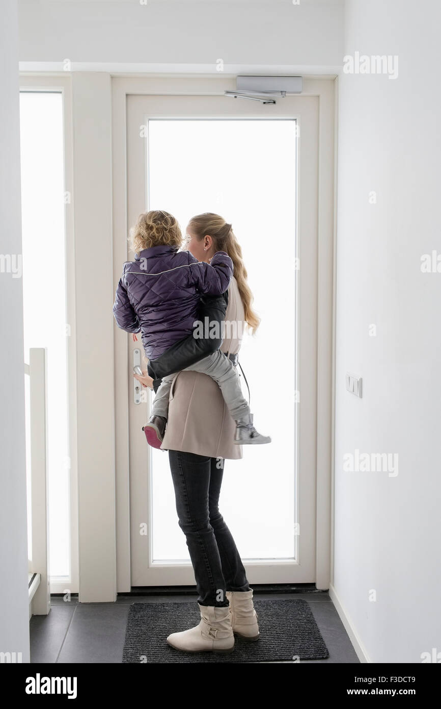 Mother holding son (4-5) - Stock Image