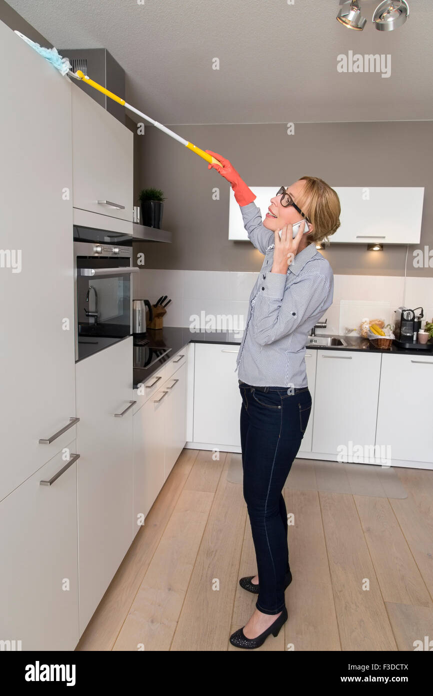 Woman cleaning house - Stock Image