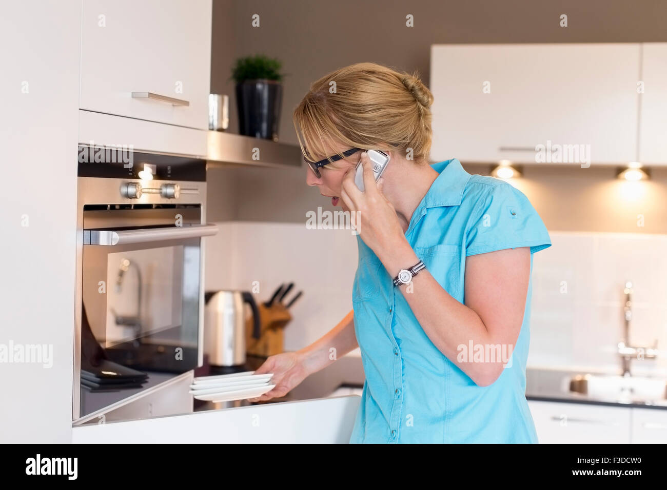 Woman cleaning house Stock Photo