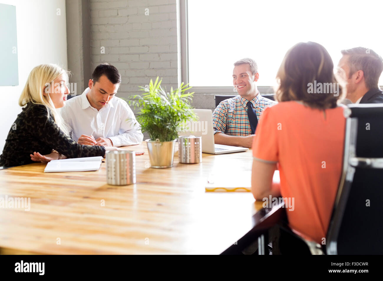Five office workers during meeting - Stock Image