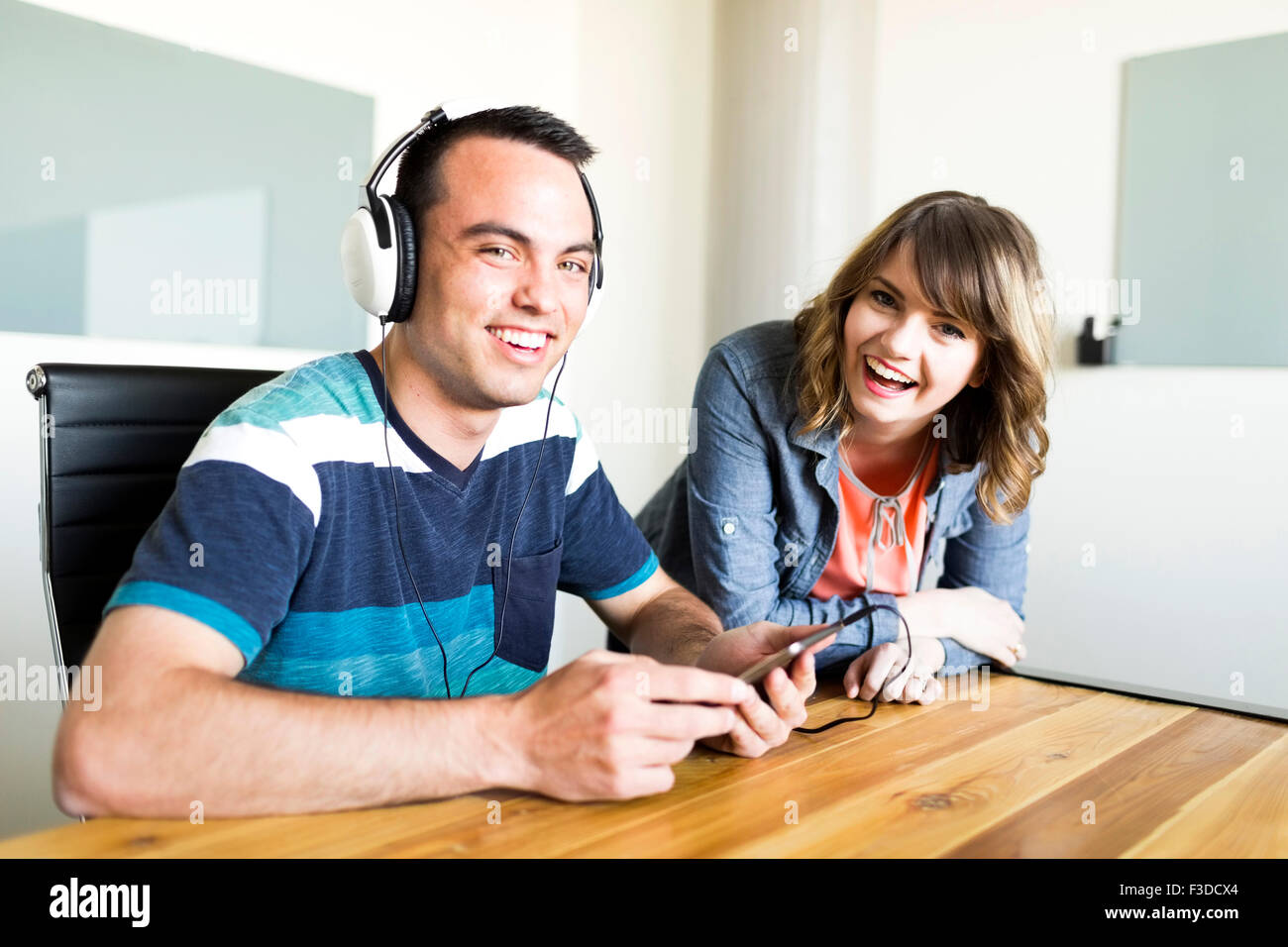 Office workers smiling - Stock Image