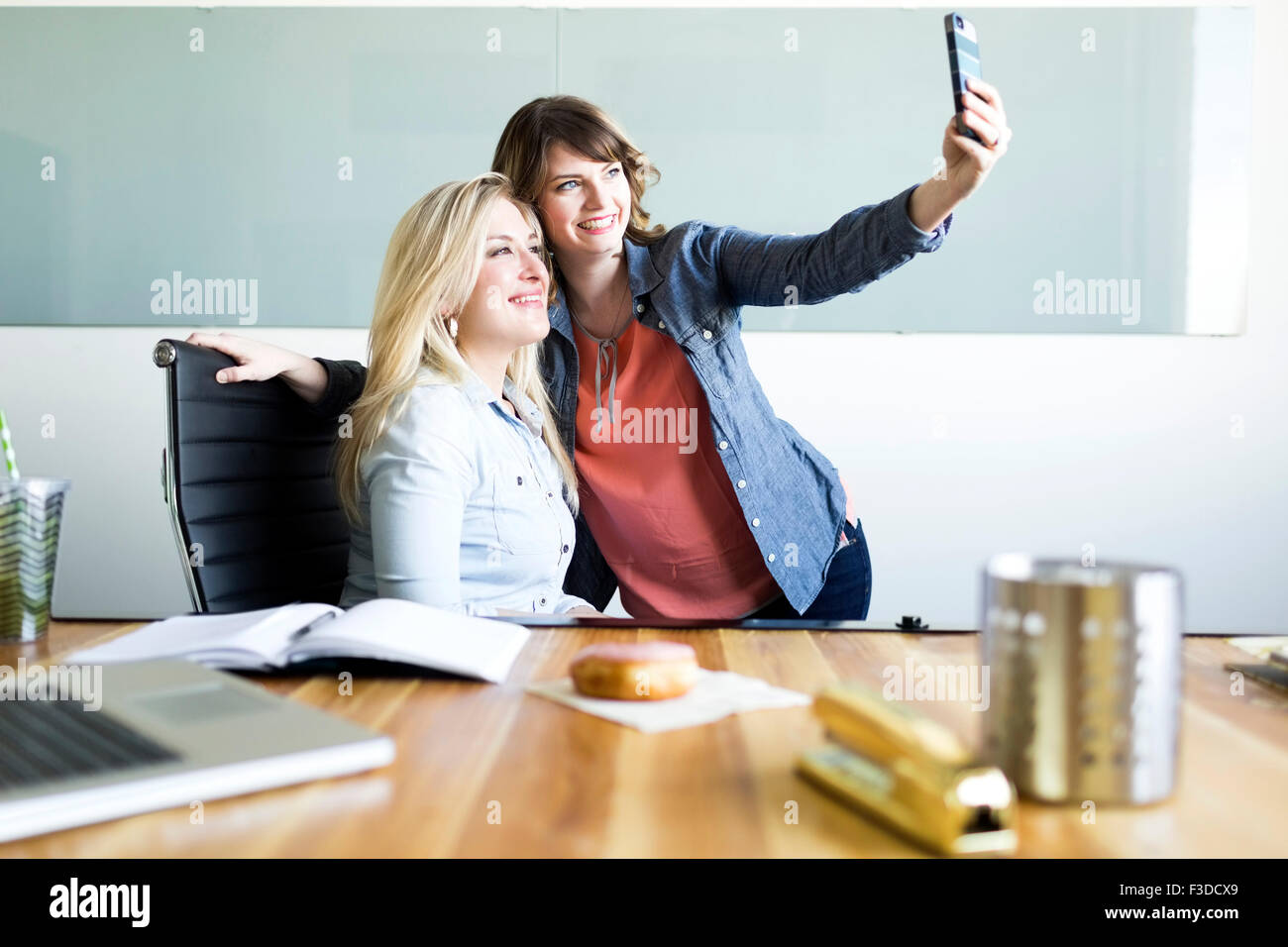 Office workers taking selfie - Stock Image