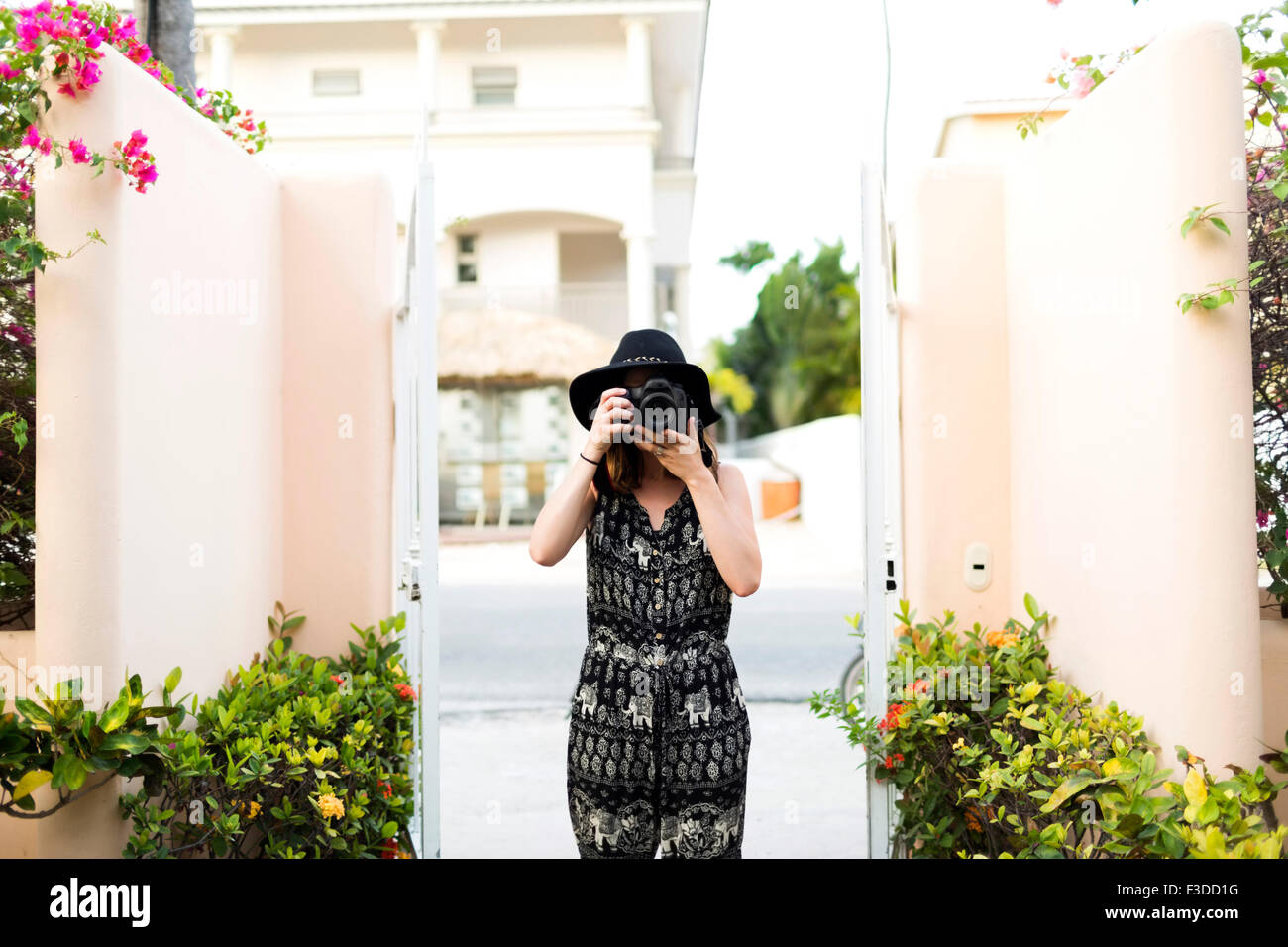 Woman taking photos during vacations Stock Photo