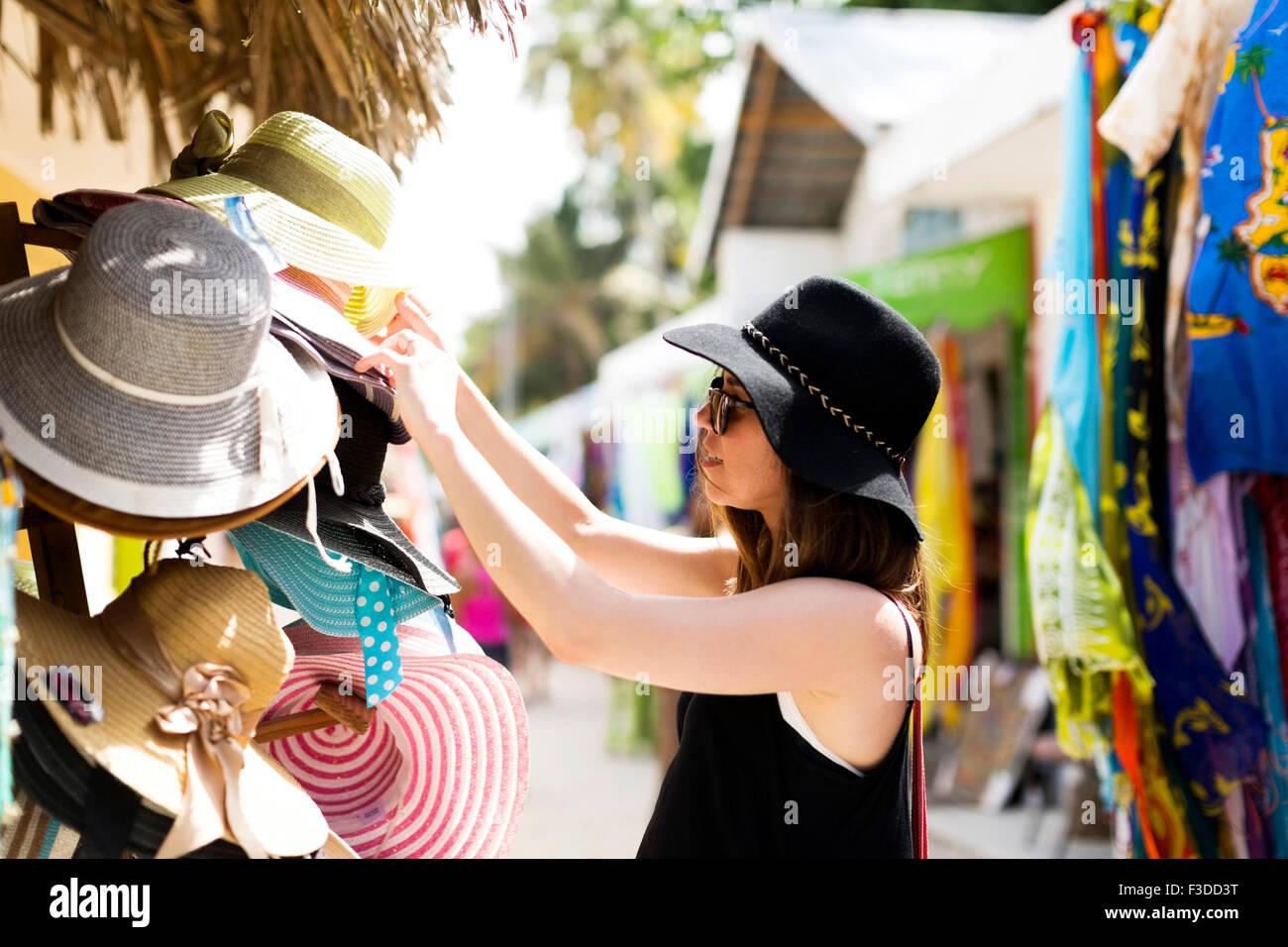 Woman looking at hats - Stock Image