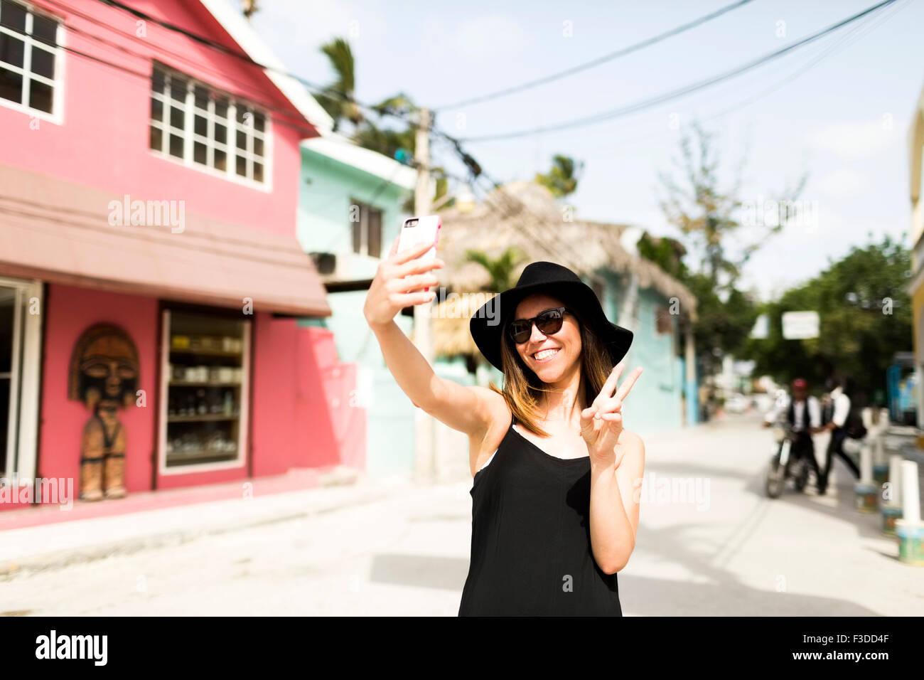 Woman photographing self - Stock Image