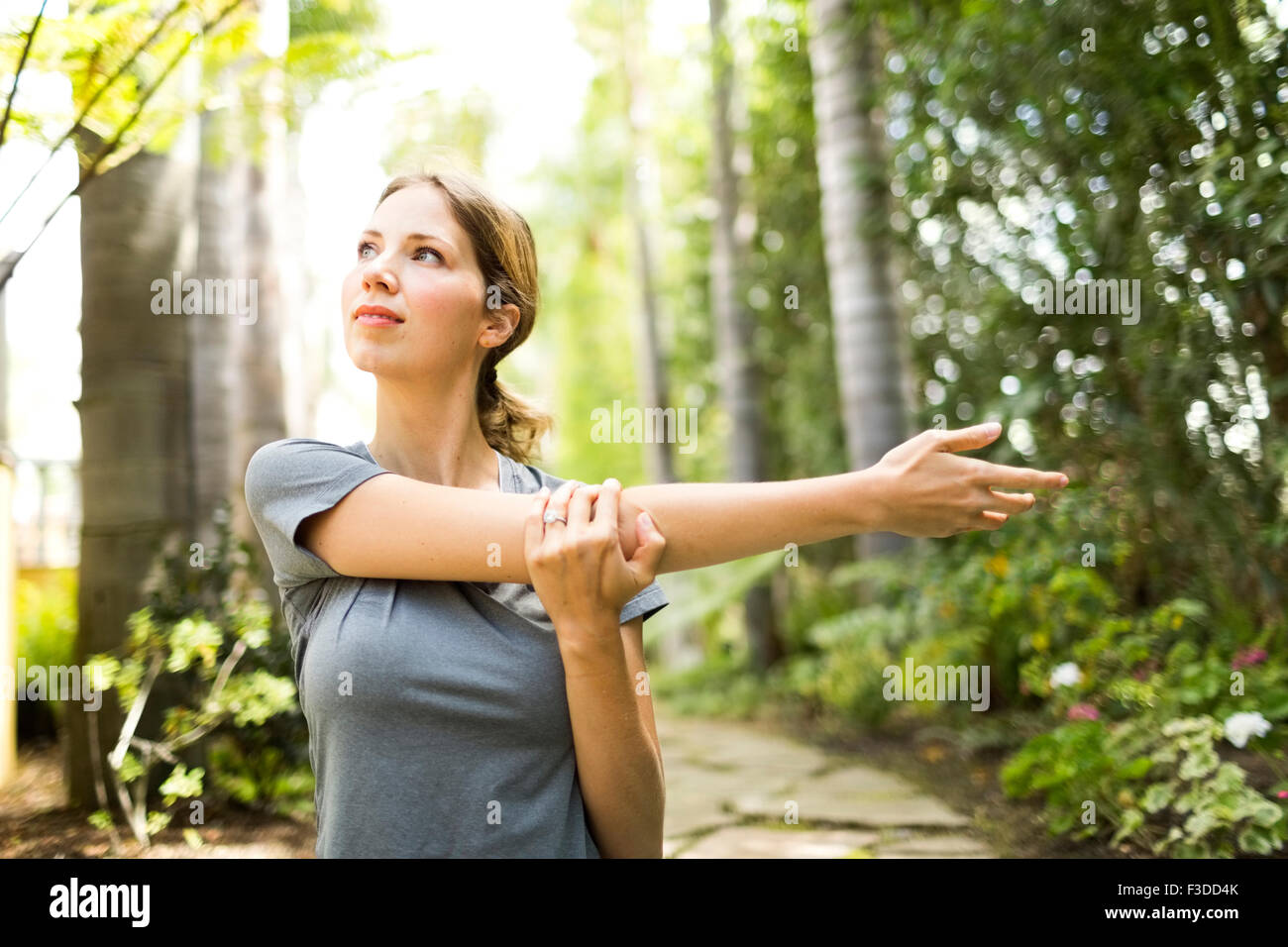 Woman practicing yoga - Stock Image