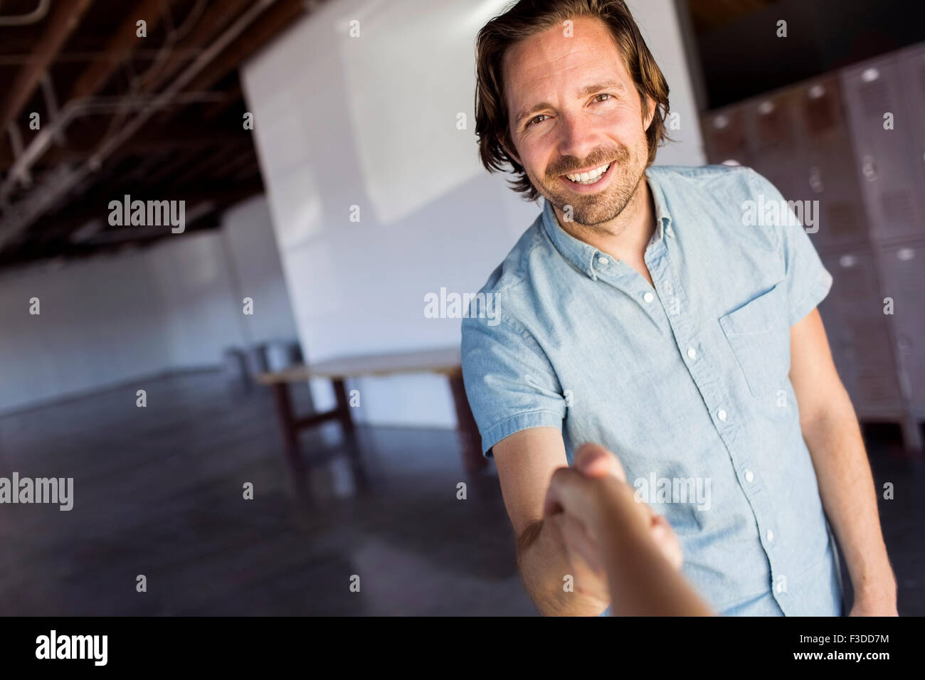 Man in warehouse - Stock Image