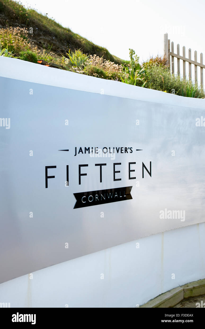 Sign at the entrance to Jamie Oliver's Fifteen restaurant in Watergate Bay, Cornwall. - Stock Image