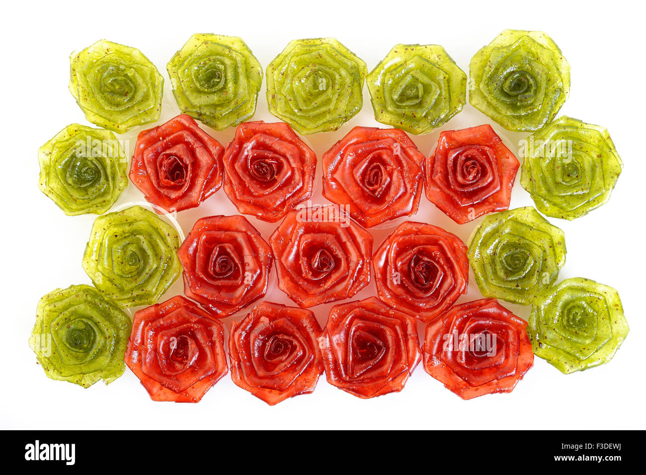 kiwi and strawberry jam pastry in the form of rose on white background - Stock Image