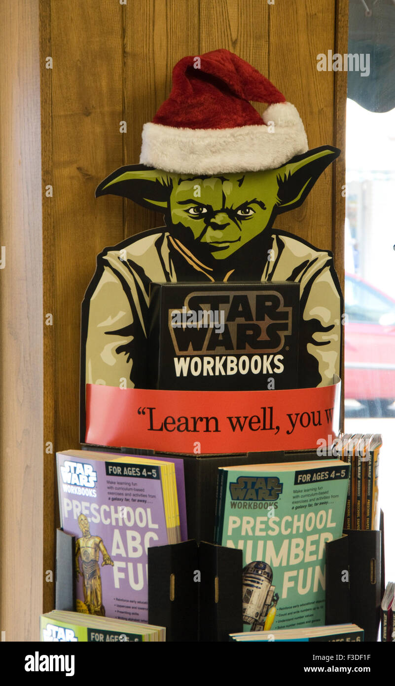 992e52f378bd7 Bookstore sign featuring Star Wars character Yoda in Santa hat Stock ...