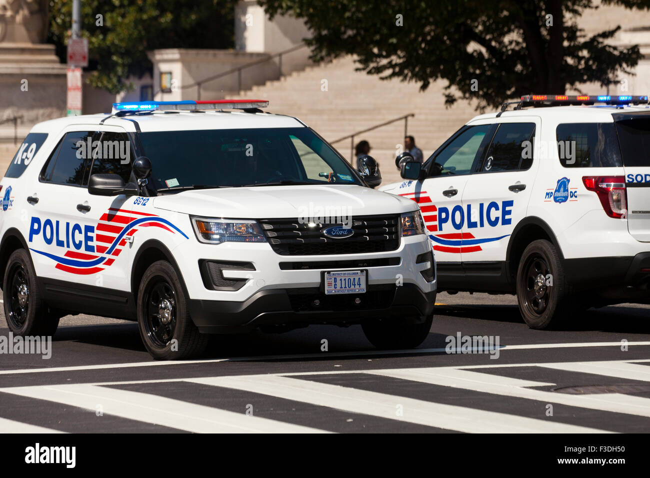 MPD SUV cruisers blocking city street - Washington, DC USA - Stock Image