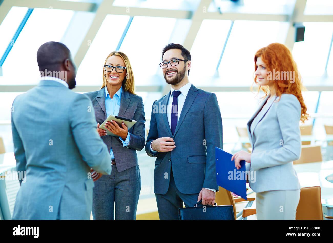 Happy multi-ethnic business people having consultation - Stock Image