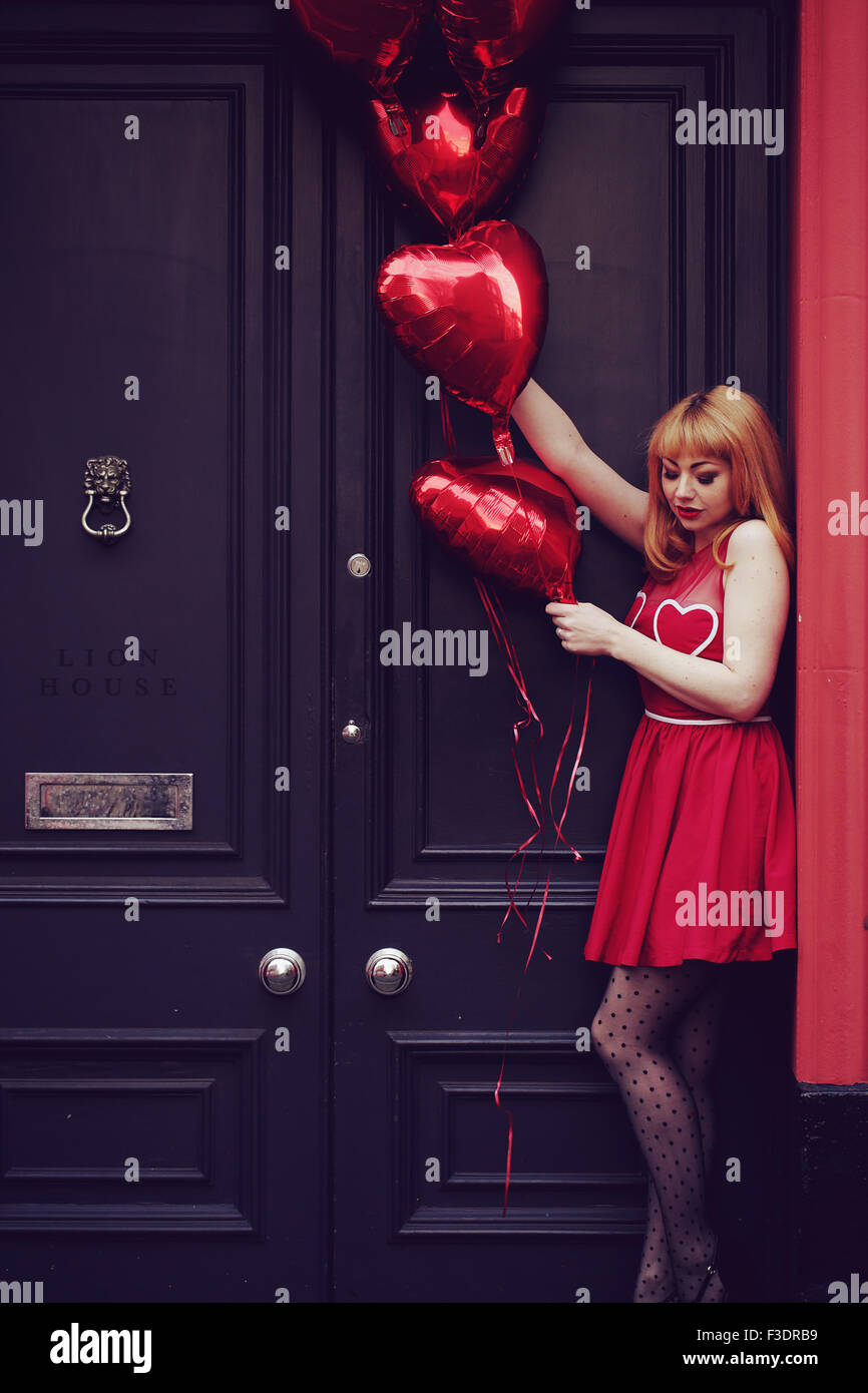Young romantic themed woman in urban area - Stock Image