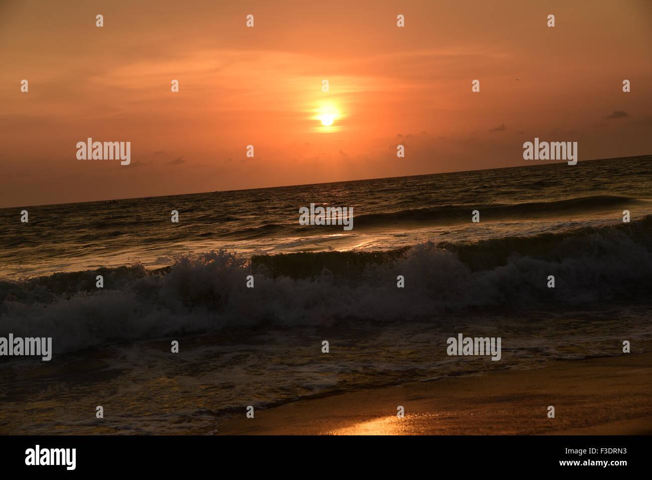 Sunset over ocean and beach in Kerala India.Bekal fort beach Kasargode Beach,cloud,flat,horizon,india,indian,kerala,ocean - Stock Image