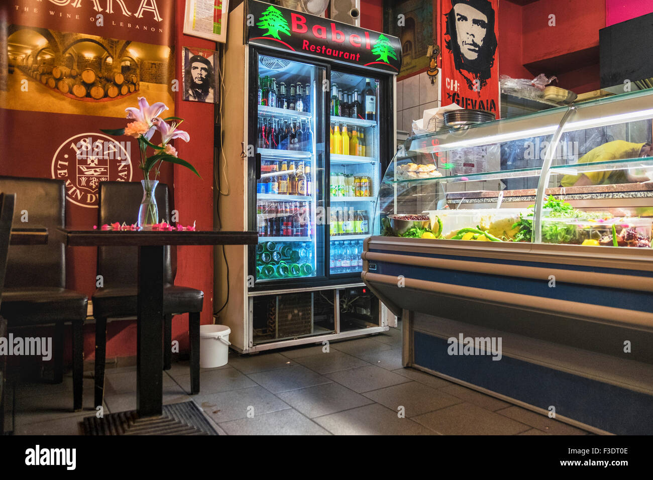 Berlin Babel Lebanese restaurant and takeaways - Exotic food, Colourful interior artwork and flower adorned alfresco - Stock Image