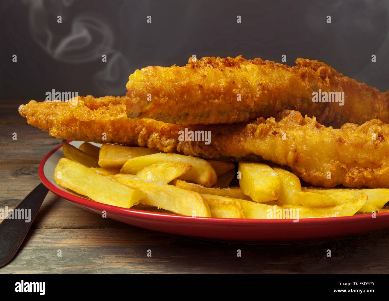 Close up of freshly made fish and chips - Stock Image