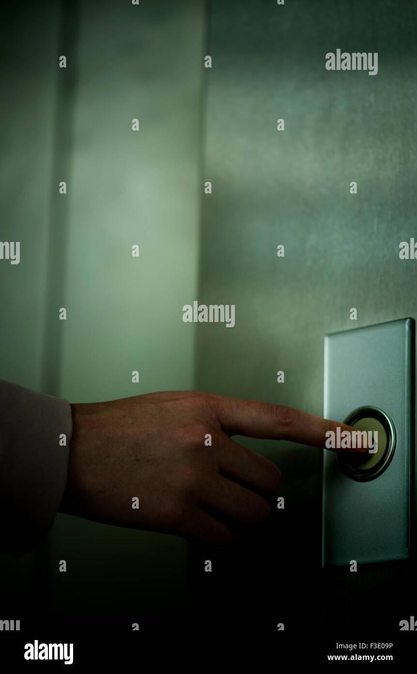Pushing door bell - Stock Image