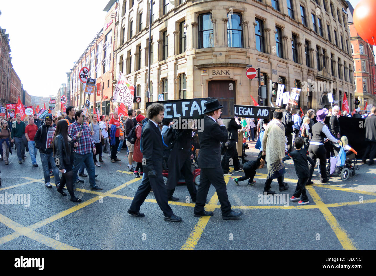 Anti-austerity march through Manchester city centre during the Conservative Party Conference. - Stock Image