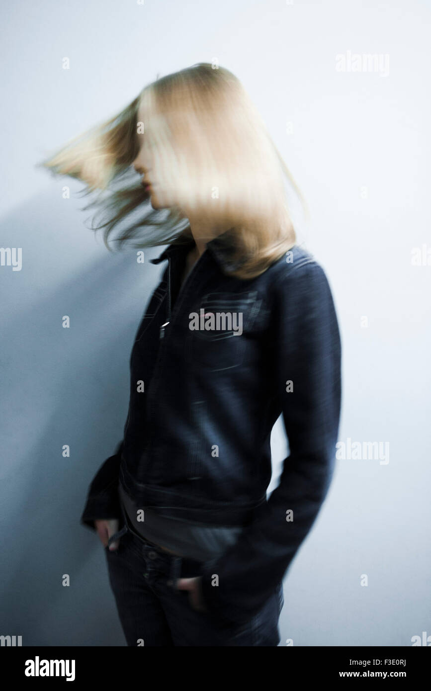 Woman tossing hair - Stock Image