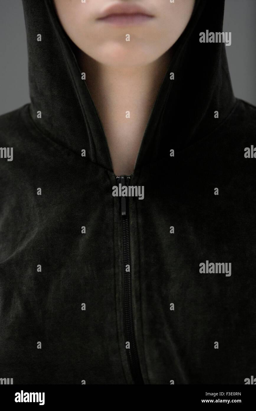Woman wearing hooded sweatshirt, portrait - Stock Image
