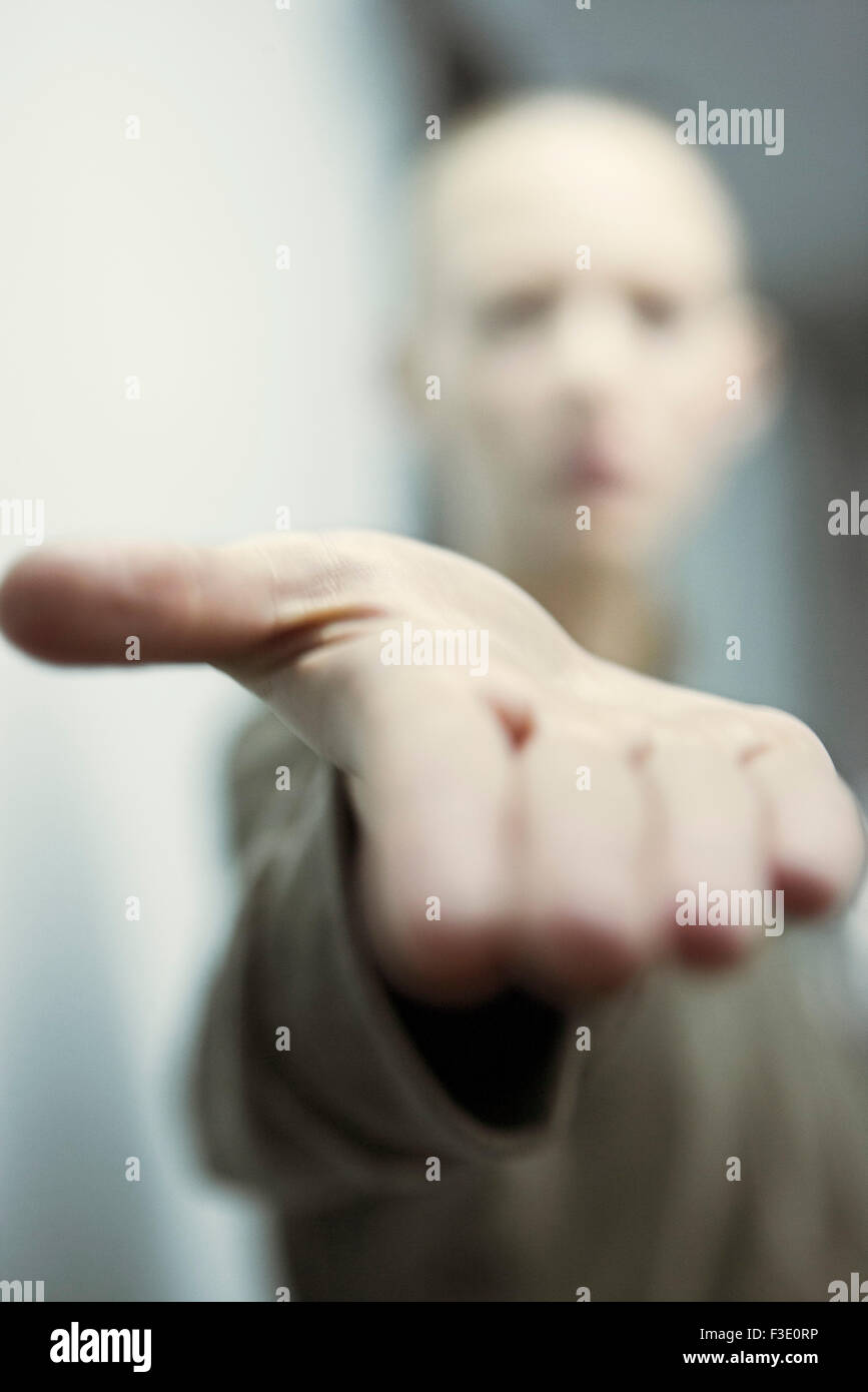 Woman extending hand asking for help, personal perspective - Stock Image