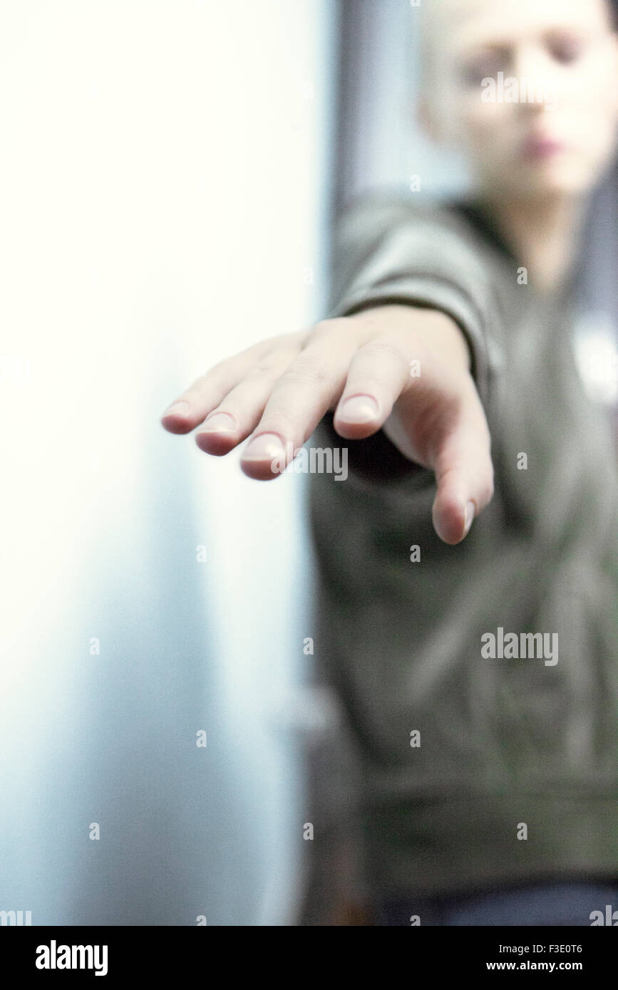 Woman reaching for something just out of reach, personal perspective - Stock Image