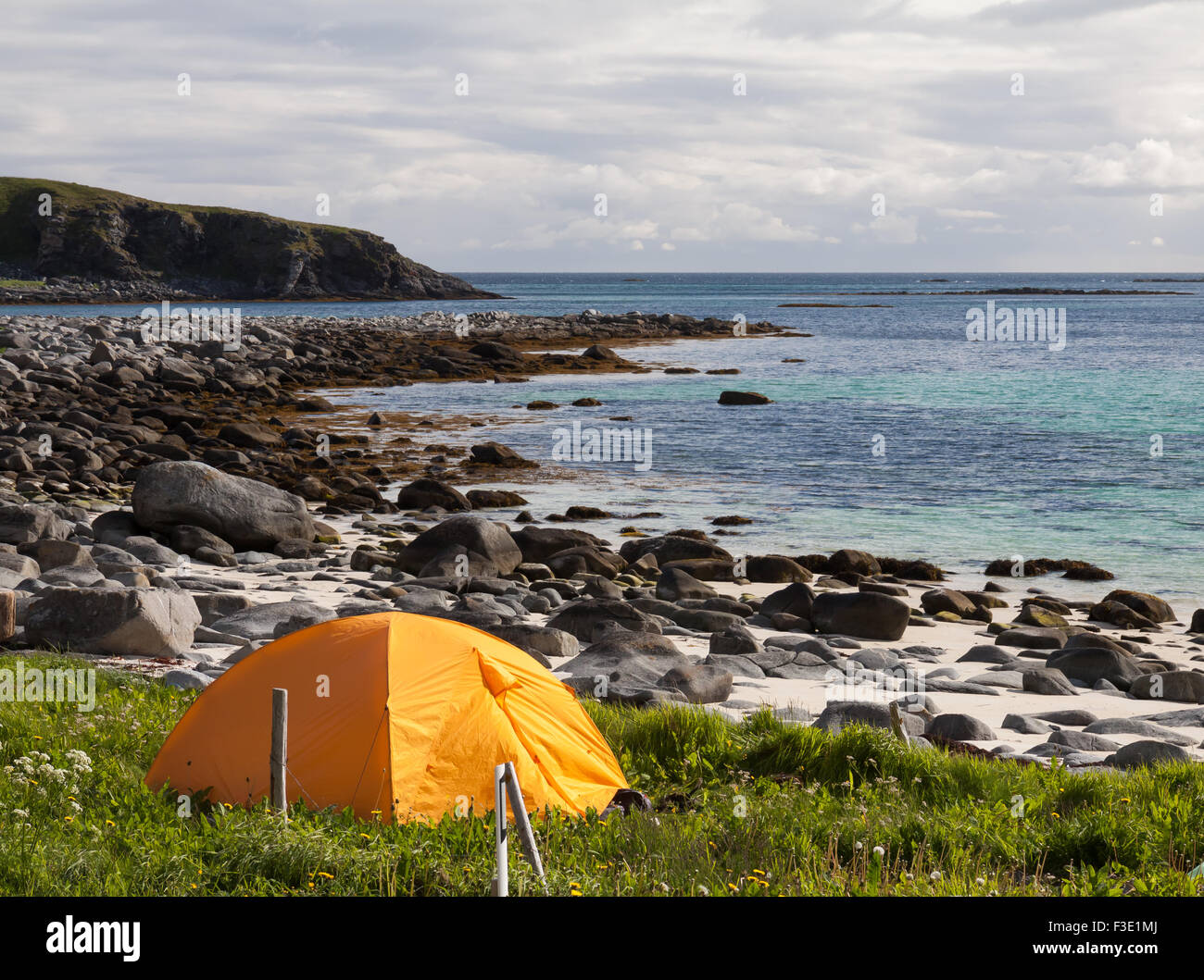 tourist tent on ocean beach and mountains - Stock Image