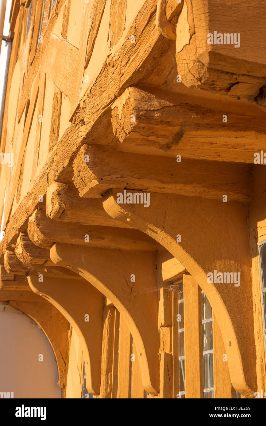 Medieval building, detail of the jettied front and oak corbels of Little Hall, a medieval half timbered hall house - Stock Image