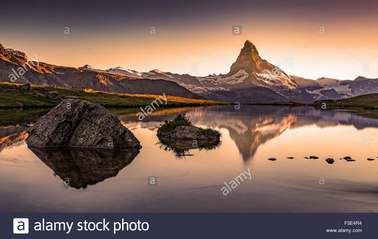 Sunset, Lights on the Matterhorn (Cervino). Lake Stellisee. Stock Photo